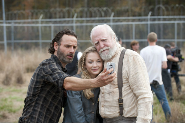 "<div class=""meta ""><span class=""caption-text "">Andrew Lincoln (Rick Grimes), Emily Kinney (Beth Greene) and Scott Wilson (Hershel Green) pose for a selfie on the set of AMC's 'The Walking Dead' season 4. The finale aired on March 30, 2014. (Gene Page / AMC)</span></div>"