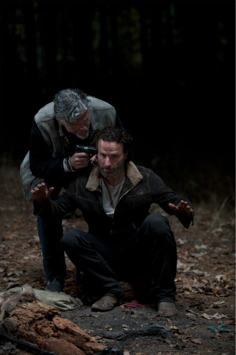 Jeff Kober &#40;Joe&#41; holds a gun to Rick Grimes&#39; &#40;Andrew Lincoln&#41; head in what he says is retaliation for his killing of a member of his group, in this scene from AMC&#39;s &#39;The Walking Dead&#39; season 4 finale, which aired on March 30, 2014. <span class=meta>(Gene Page &#47; AMC)</span>