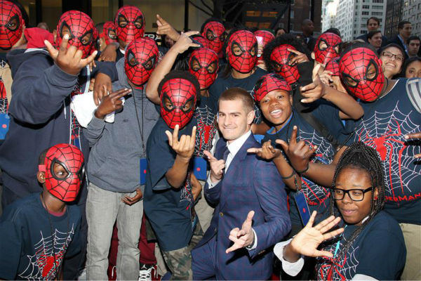 "<div class=""meta image-caption""><div class=""origin-logo origin-image ""><span></span></div><span class=""caption-text"">Andrew Garfield poses with fans at the premiere of 'The Amazing Spider-Man 2' in New York on April 24, 2014. He plays Spider-Man / Peter Parker. He is wearing a blue and purple checked Alexander McQueen. (Dave Allocca / Startraksphoto.com)</span></div>"