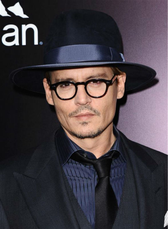 Johnny Depp appears at the premiere of the movie &#39;3 Days To Kill&#39; in Los Angeles on Feb. 12, 2014. He arrived with reported fiancee Amber Heard, who is one of the cast members. It was reported in January that the two are engaged, although the pair has not confirmed this. <span class=meta>(Sara De Boer &#47; Startraksphoto.com)</span>