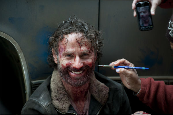 "<div class=""meta ""><span class=""caption-text "">Andrew Lincoln (Rick Grimes) appears on the set of AMC's 'The Walking Dead' season 4 finale, which aired on March 30, 2014. He is bloody because he filmed a scene in which he kills Joe in a pretty grotesque way. Lincoln said on 'Talking Dead' that he had to bite a piece of raw chicken for the scene. (Gene Page / AMC)</span></div>"