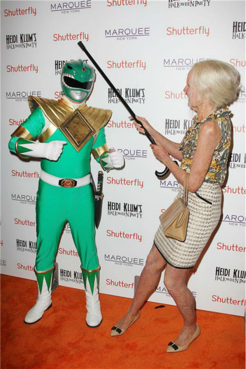 Heidi Klum, dressed in an elderly woman costume, pretends to fight a person dressed as a Power Ranger, on the red carpet at her 14th annual Halloween party, held at the Marquee nightclub in New York on Oct. 31, 2013. <span class=meta>(Amanda Schwab &#47; Startraksphoto.com)</span>