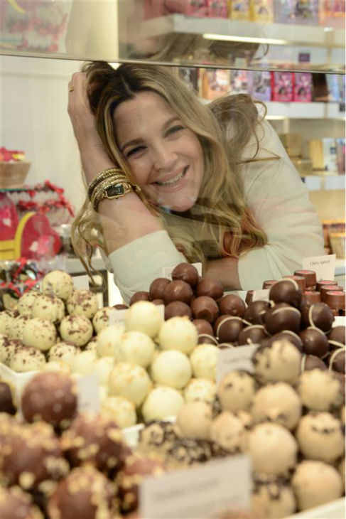 Drew Barrymore, who is pregnant with her second child, appears at a Godiva chocolate shop in Los Angeles on Jan. 29, 2014 to kick off a Valentine's Day partnership to promote her book 'Find It In Everything.'