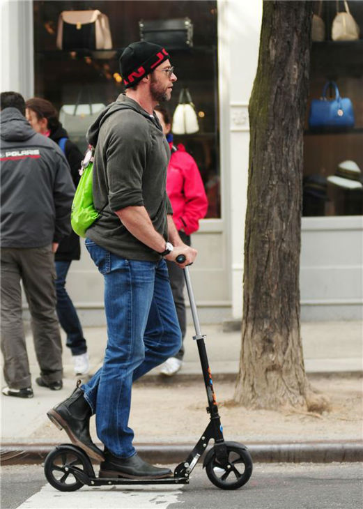 Hugh Jackman rides a scooter in New York City on April 22, 2013.
