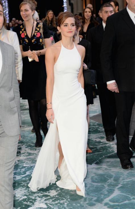 "<div class=""meta image-caption""><div class=""origin-logo origin-image ""><span></span></div><span class=""caption-text"">Emma Watson, wearing a one-of-a-kind, flowing, white Ralph Lauren collection halter gown, appears at the 'Noah' London premiere on March 31, 2014. She plays Ila, wife of Noah's son Shem, in the film. (Dave J Hogan / Getty Images for Paramount Pictures International)</span></div>"