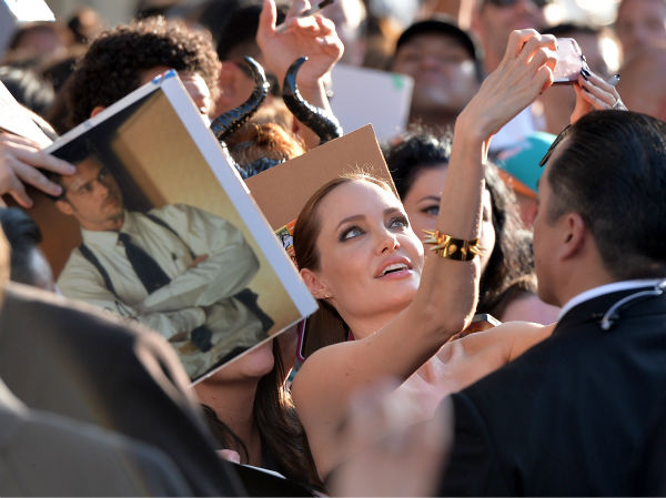 Angelina Jolie takes a selfie with a fan at the premiere of Disney&#39;s &#39;Maleficent&#39; in Hollywood, California on May 28, 2014. <span class=meta>(Alberto E. Rodriguez &#47; Getty Images for Disney)</span>