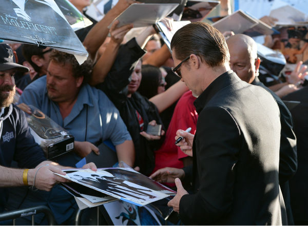 Brad Pitt appears with fans at the premiere of Disney&#39;s &#39;Maleficent,&#39; which stars his partner, Angelina Jolie, in Hollywood, California on May 28, 2014. <span class=meta>(Alberto E. Rodriguez &#47; Getty Images for Disney)</span>