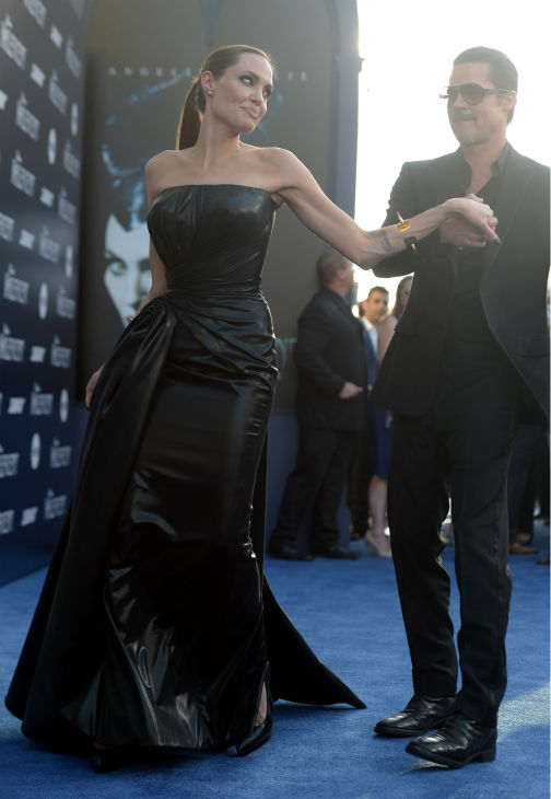 Angelina Jolie and Brad Pitt attend the premiere of Disney&#39;s &#39;Maleficent&#39; in Hollywood, California on May 28, 2014. <span class=meta>(Jason Kempin &#47; Getty Images for Disney)</span>
