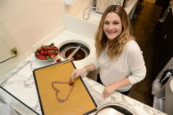 "<div class=""meta ""><span class=""caption-text "">Drew Barrymore, who is pregnant with her second child, appears at a Godiva chocolate shop in Los Angeles on Jan. 29, 2014 to kick off a Valentine's Day partnership to promote her book 'Find It In Everything.' (Michael Simon / Startraksphoto.com)</span></div>"