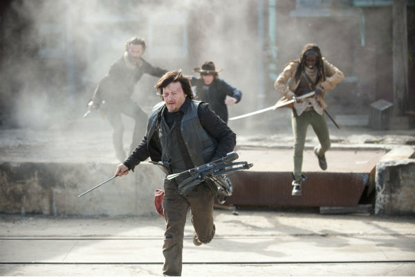 Rick Grimes &#40;Andrew Lincoln&#41;, Carl Grimes &#40;Chandler Riggs&#41;, Daryl Dixon &#40;Norman Reedus&#41; and Michonne &#40;Danai Gurira&#41; run from snipers in Terminus ... and are essentially herded, as seen in this scene from AMC&#39;s &#39;The Walking Dead&#39; season 4 finale, which aired on March 30, 2014. <span class=meta>(Gene Page &#47; AMC)</span>