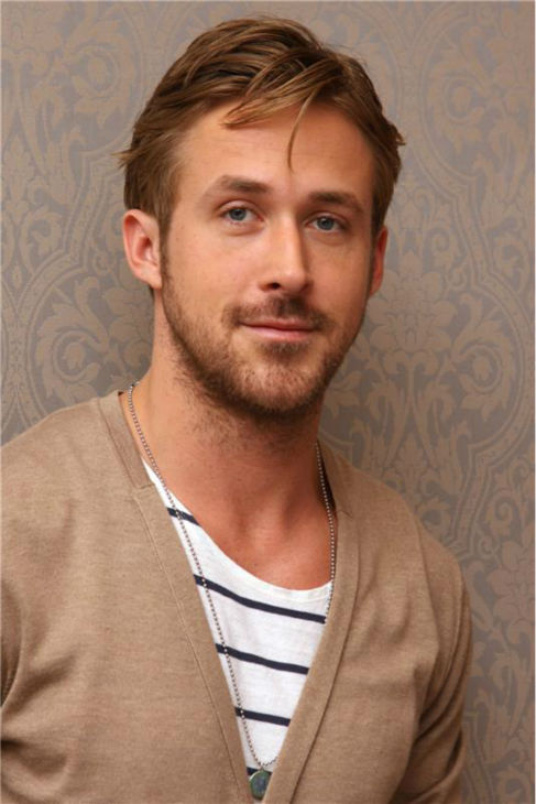 The 'I-Never-Match-My-Shirt-To-The-Wallpaper' stare: Ryan Gosling appears at a press conference for 'Crazy Stupid Love' in New York on July 19, 2011.