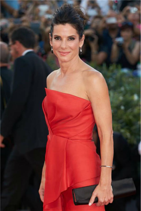 Sandra Bullock walks the red carpet at the premiere of the film &#39;Gravity&#39; at the 70th annual Venice International Film Festival on Aug. 28, 2013. She is wearing a red, silk, strapless J. Mendel Resort 2014 &#39;Siren&#39; gown. <span class=meta>(Action Press &#47; Startraksphoto.com)</span>