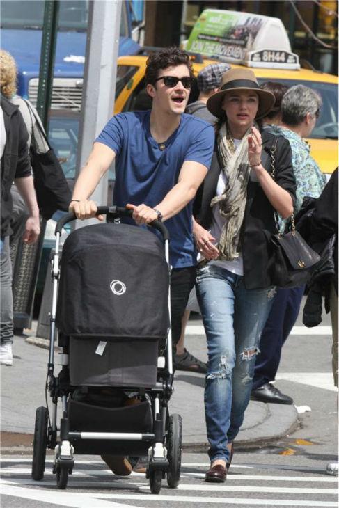 Orlando Bloom and Miranda Kerr take their son Flynn for a stroll in New York on May 1, 2011.  <span class=meta>(Adam Nemser &#47; Startraksphoto.com)</span>