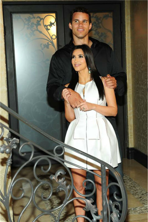 Kim Kardashian and then-fiance Kris Humphries appear at their engagement party, thrown by Kim's sister Khloe, in Los Angeles on June 16, 2011.