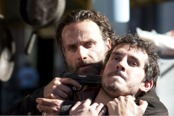 Rick Grimes &#40;Andrew Lincoln&#41; holds a gun to Alex&#39;s &#40;Tate Ellington&#41; face after spotting Terminus residents wearing his friends&#39; personal belongings in this scene from AMC&#39;s &#39;The Walking Dead&#39; season 4 finale, which aired on March 30, 2014. <span class=meta>(Gene Page &#47; AMC)</span>