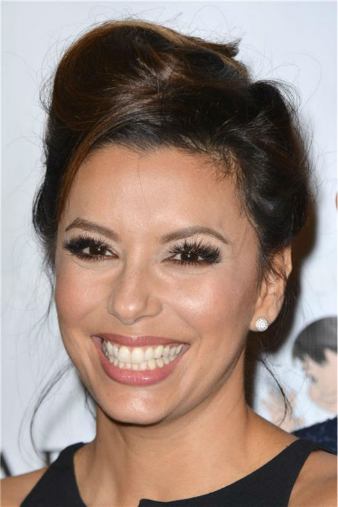 Eva Longoria poses at the El Sueno De Esperanza gala, hosted by PADRES Contra El Cancer, at Club Nokia in Los Angeles on Sept. 24, 2013. <span class=meta>(Lionel Hahn &#47; AbacaUSA &#47; Startraksphoto.com)</span>