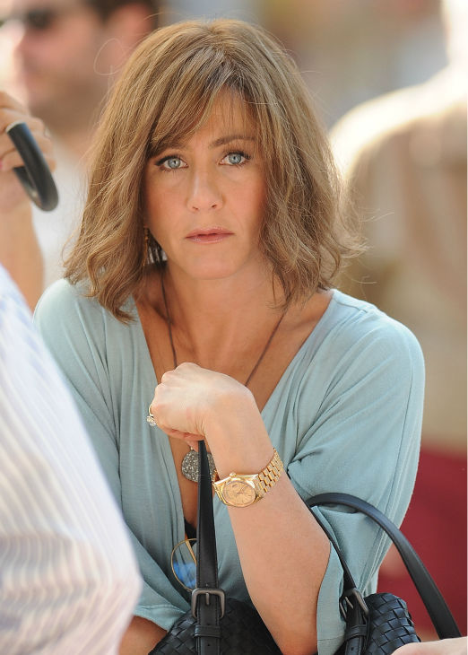 "<div class=""meta image-caption""><div class=""origin-logo origin-image ""><span></span></div><span class=""caption-text"">Jennifer Aniston wears a wig on the New York City set of the 2014 movie 'Squirrels To The Nuts' on July 17, 2013. (Humberto Carreno / startraksphoto.com)</span></div>"