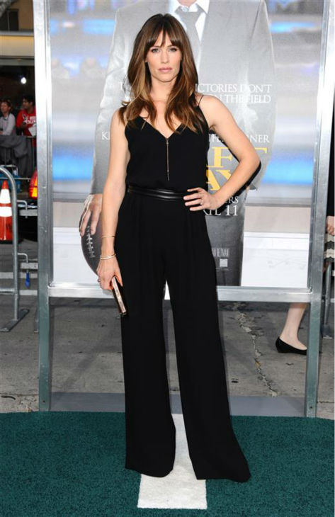 First, check out how gorgeous Jennifer Garner looks in that black jumpsuit. Now that we have established that she looks gorgeous, we can focus on the real star of the show -- her perfect hair.  &#40;Pictured: Jennifer Garner appears at the premiere of &#39;Draft Day&#39; in Westwood, near Los Angeles, on April 7, 2014.&#41; <span class=meta>(Sara De Boer &#47; Startraksphoto.com)</span>