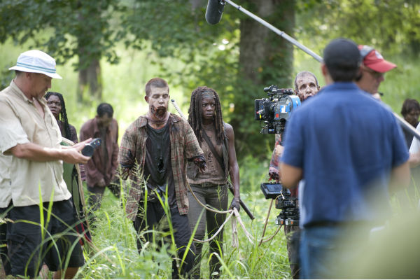 Danai Gurira &#40;Michonne&#41; and actors dressed as Walkers appear on the set of AMC&#39;s &#39;The Walking Dead&#39;s season 4 midseason premiere, titled &#39;After,&#39; which aired on Feb. 9, 2014. <span class=meta>(Gene Page &#47; AMC)</span>
