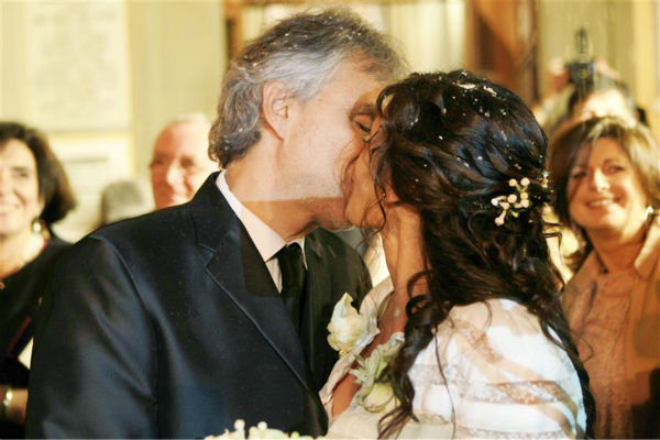 Andrea Bocelli and longtime partner Veronica Berti kiss at their wedding at the Sanctuary of Montenero in Italy on March 21, 2014. This marks the second marriage for the famed Italian tenor. He and Berti are parents to a daughter, who celebrated her second birthday on their wedding day, and he also has two sons from a previous marriage. <span class=meta>(Masjordan Image &#47; Abaca &#47; Startraksphoto.com)</span>