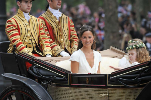Pippa Middleton appears at her sister Kate Middleton&#39;s Royal Wedding to Prince William at Westminster Abbey in London on April 29, 2011. Pippa became famous due to her a cowl-neck, body-hugging, ivory bridesmaid gown by Sarah Burton at Alexander McQueen. <span class=meta>(Rex Features &#47; Startraksphoto.com)</span>