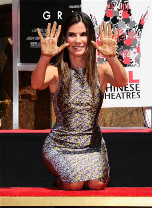 "<div class=""meta image-caption""><div class=""origin-logo origin-image ""><span></span></div><span class=""caption-text"">Sandra Bullock removes her hands from wet cement at a ceremony at the TCL Chinese Theatre in Hollywood on Sept. 25, 2013. (Sara De Boer / Startraksphoto.com)</span></div>"