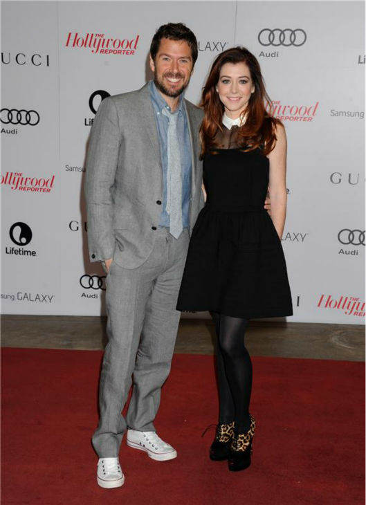 Alyson Hannigan &#40;&#39;How I Met Your Mother&#39;&#41; and husband Alexis Denisof &#40;fellow &#39;Buffy The Vampire Slayer&#39; alum&#41; attend the Hollywood Reporter&#39;s 2013 Women In Entertainment Breakfast in Beverly Hills, California on Dec. 11, 2013. <span class=meta>(Daniel Robertson &#47; Startraksphoto.com)</span>