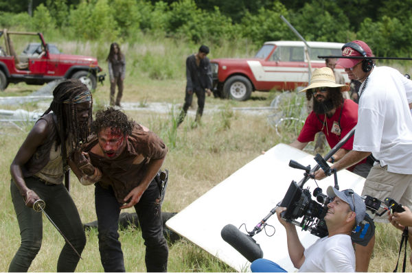 Danai Gurira &#40;Michonne&#41; and Andrew Lincoln &#40;Rick Grimes&#41; appear on the set of AMC&#39;s &#39;The Walking Dead&#39;s season 4 midseason finale, which aired on Dec. 1, 2013. <span class=meta>(Gene Page &#47; AMC)</span>