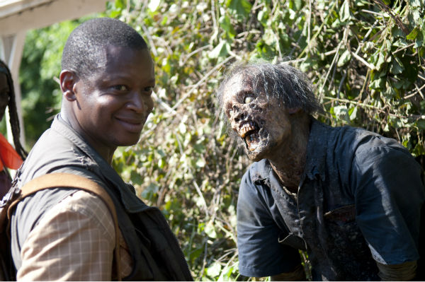 "<div class=""meta ""><span class=""caption-text "">An actor dressed as a Walker and Lawrence Gilliard Jr. (Bob Stookey) appear on the set of AMC's 'The Walking Dead' while filming episode 4 of season 4, titled 'Indifference,' which aired on Nov. 3, 2013. (Gene Page / AMC)</span></div>"