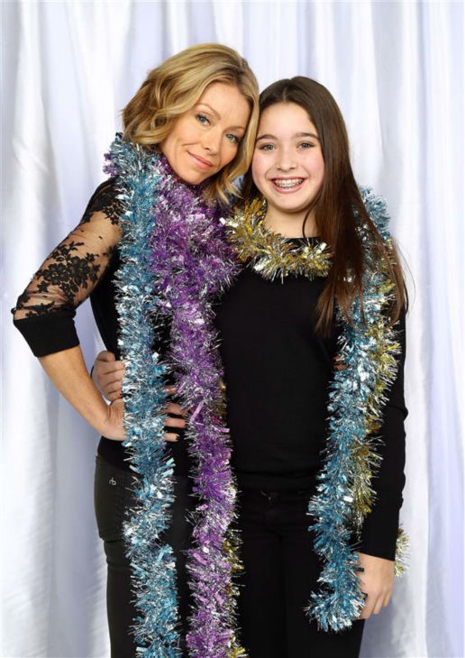 Kelly Ripa and daughter Lola Consuelos pose in a holiday-themed photo booth at Z100&#39;s Jingle Ball 2013 on Dec. 13, 2013, just before Christmas. <span class=meta>(Sara Jaye Weiss  &#47; Startraksphoto.com)</span>