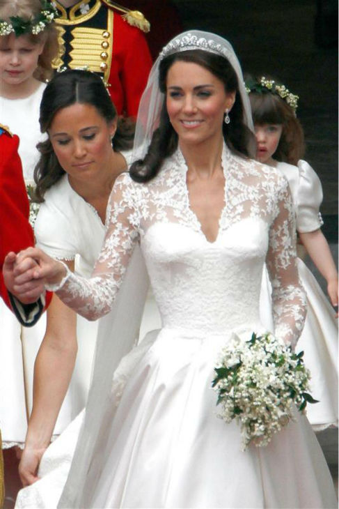 Pippa Middleton smoothes out her sister Kate Middleton&#39;s train at her Royal Wedding to Prince William at Westminster Abbey in London on April 29, 2011. Pippa became famous due to her a cowl-neck, body-hugging, ivory bridesmaid gown by Sarah Burton at Alexander McQueen. <span class=meta>(AMH &#47; Startraksphoto.com)</span>