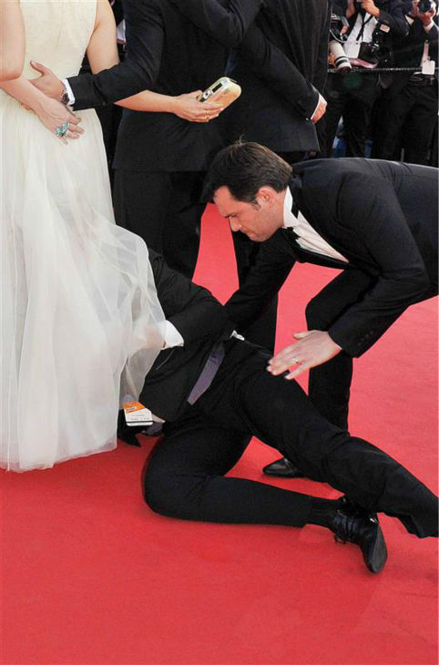 A security official tries to restrain notorious prankster of celebrities, Ukrainian reporter Vitalii Sediuk, after he crawled under actress America Ferrera&#39;s ball gown at a screening of &#39;How To Train Your Dragon 2&#39; at the 2014 Cannes Film Festival on Friday, May 16, 2014. <span class=meta>(Camilla Morandi &#47; IPA &#47; Startraksphoto.com)</span>