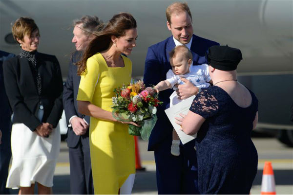 Kate Middleton, aka Catherine, Duchess of Cambridge, son Prince George and husband Prince William are greeted by an official after they land in Sydney, Australia, as part of their Royal Tour. <span class=meta>(Paul McConnell &#47; Startraksphoto.com)</span>