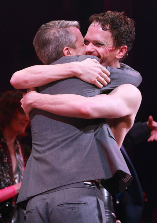 Neil Patrick Harris hugs writer John Cameron Mitchell on stage during opening night of the rock musical &#39;Hedwig and the Angry Itch&#39; on Broadway in New York on April 22, 2014. The &#39;How I Met Your Mother&#39; and &#39;Doogie Howser&#39; alum plays a transgender East German rocker in the show, which is set during the Cold War. Hedwig lives in a trailer park in Kansas and is the singer of a band called the Angry Itch. She longs to be reunited with her lover, Tommy. <span class=meta>(Adam Nemser &#47; Startraksphoto.com)</span>