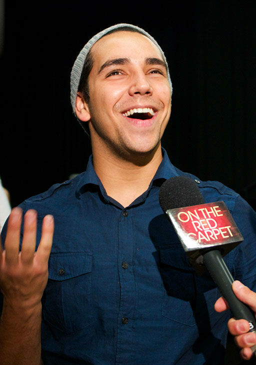 "<div class=""meta ""><span class=""caption-text "">Lazaro Arbos talks to OTRC.com at a rehearsal for the 'American Idol LIVE!' 2013 summer tour in Burbank, California on July 9, 2013. He is one of 11 singers who competed during the recent 12th season, coming in 6th place, and will perform at 30 concerts across the United States and Canada, from July 19 to Aug. 31. (Aaron Frank / OTRC)</span></div>"