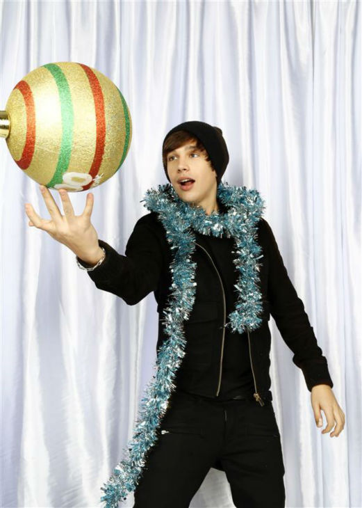 "<div class=""meta image-caption""><div class=""origin-logo origin-image ""><span></span></div><span class=""caption-text"">Pop singer Austin Mahone poses in a holiday-themed photo booth at Z100's Jingle Ball 2013 on Dec. 13, 2013, just before Christmas. (Sara Jaye Weiss  / Startraksphoto.com)</span></div>"