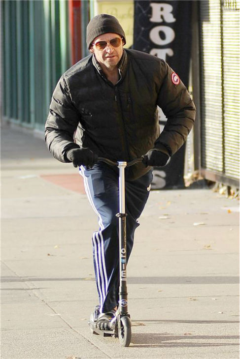 Hugh Jackman rides a scooter in New York City on Nov. 20, 2013. <span class=meta>(Humberto Carreno &#47; Startraksphoto.com)</span>