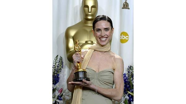 Jennifer Connelly poses with her award for best supporting actress for her work in 'A Beautiful Mind,' at the 74th annual Academy Awards on Sunday, March 24, 2002, in Los Angeles. (AP Photo/Doug Mills)