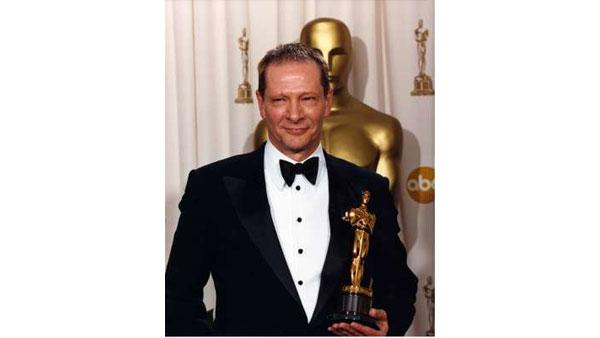 Best Supporting Actor winner Chris Cooper holds his Oscar backstage at the 75th Anniversary Academy Awards, Sunday March 23, 2003 at the Kodak Theatre in Hollywood.
