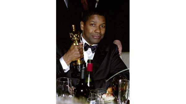 Winner of the Best Actor Academy Award for his performance in 'Training Day', Denzel Washington poses for a photo at the Govenor's Ball after the 74th Annual Academy Awards, Sunday March 24, 2002.