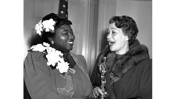 Actress Fay Bainter (right) presents Hattie McDaniel the Motion Picture Academy award for the best performance of an actress in a supporting role in 1939 for her work as 'Mammy' in the film version of 'Gone With the Wind' on Feb. 29, 1940 in L