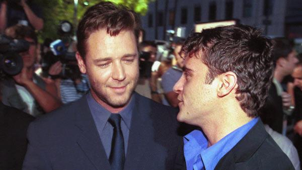 Actors Russell Crowe, left, and Joaquin Phoenix, co-stars of the movie 'Gladiator,' greet each other at a special screening of the film, Monday, May 1, 2000, at the Academy of Motion Picture Arts & Sciences in Beverly Hills, Calif.