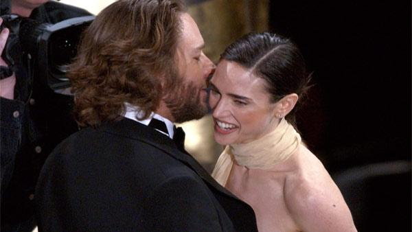 Jennifer Connelly receives a kiss from co-star Russell Crowe after winning best supporting actress for her role in A Beautiful Mind during the 74th annual Academy Awards on Sunday, March 24, 2002, in Los Angeles.