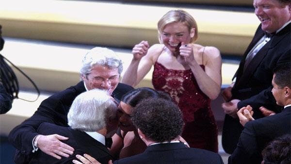 Producer Martin Richards is congratulated by Richard Gere, Catherine Zeta-Jones, John C. Reilly, bottom center, and Renee Zellweger after the film 'Chicago' won for best motion picture of the year at the 75th annual Academy Awards in 2003.