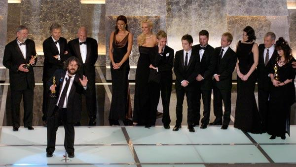 Director Peter Jackson, foreground, accepts the award for best picture for