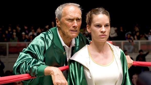 In this promotional photo released by Warner Bros. Pictures, actor and director Clint Eastwood, left, and actress Hilary Swank appear in a scene from