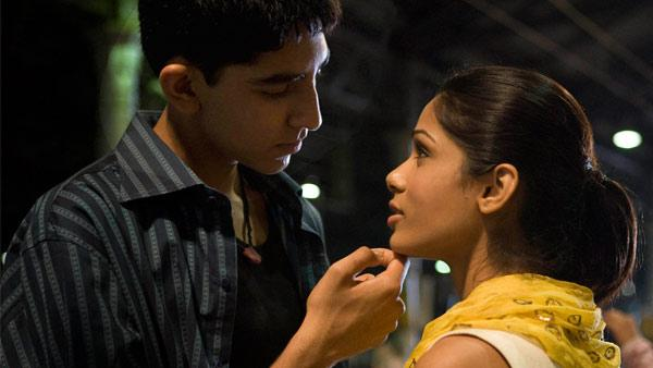 In this image released by Fox Searchlight pictures, Dev Patel, left, and Freida Pinto are shown in a scene from