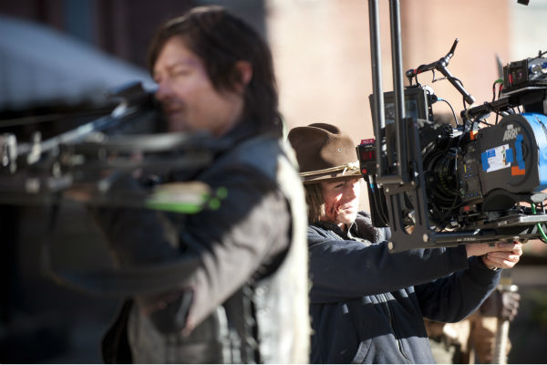 Norman Reedus &#40;Daryl Dixon&#41; and Chandler Riggs &#40;Carl Grimes&#41; film a scene for AMC&#39;s &#39;The Walking Dead&#39; season 4 finale, which aired on March 30, 2014. <span class=meta>(Gene Page &#47; AMC)</span>