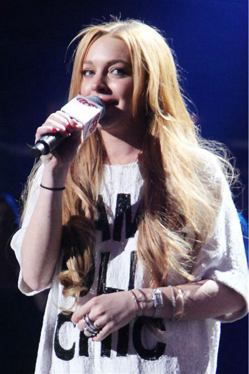 Lindsay Lohan appears on stage at the 2013 Z100 Jingle Ball on Dec. 13, 2013 and introduces singer Miley Cyrus. <span class=meta>(Amanda Schwab &#47; Startraksphotos.com)</span>