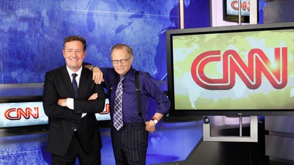 Piers Morgan and Larry King pose in an undated photo posted on CNN.com on Sept. 8, 2010. - Provided courtesy of Photo courtesy of Mathieu Young / CNN.com
